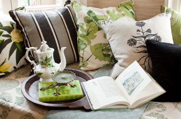 botanical leaf motif pillows on a sofa