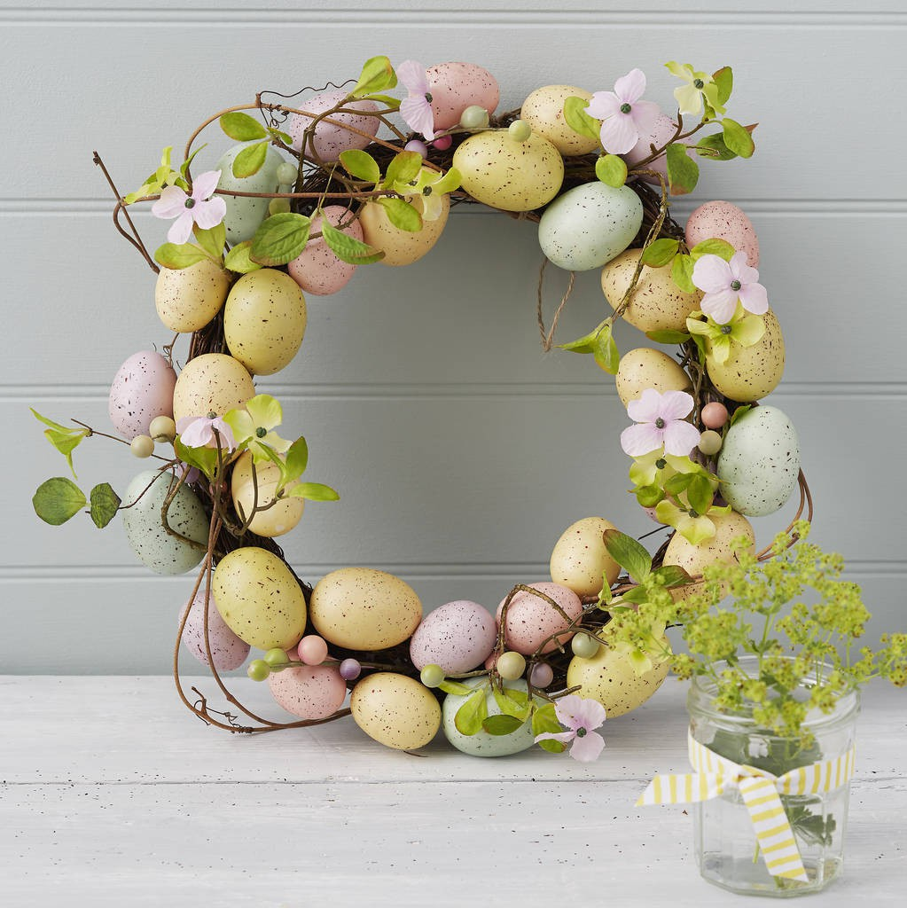 Egg and flower easter wreath lying on a door