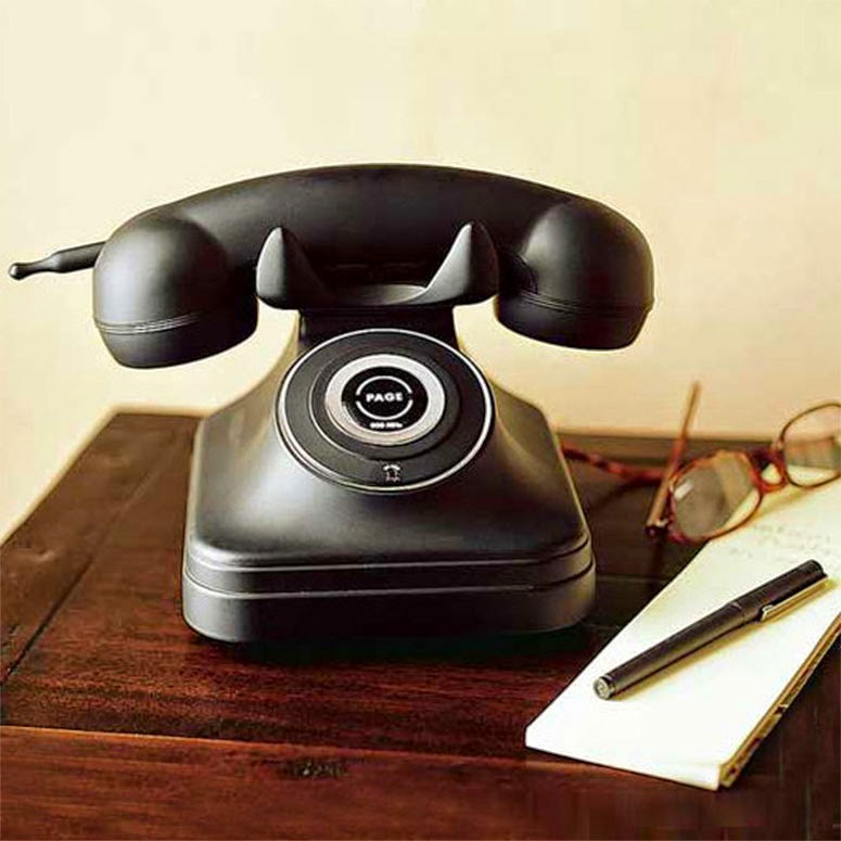 retro phone sat on a wooden desk
