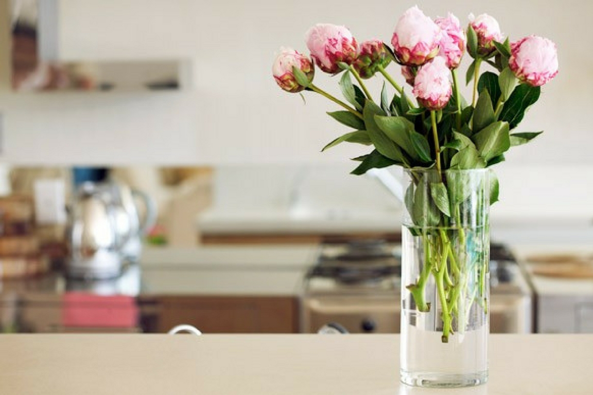 hygge Tulips in glass vase on top of table