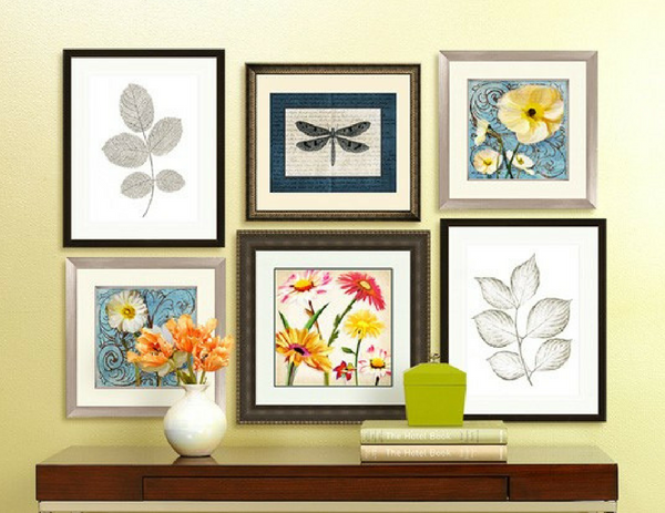 a wall gallery filled with summer inspired artwork