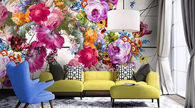 flowery mural on wall in front of couch