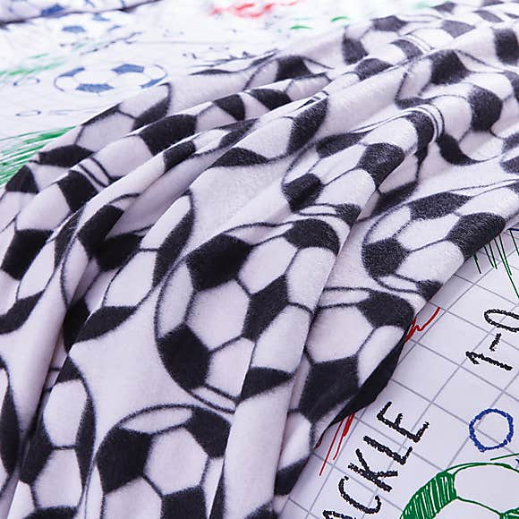 a black and white printed blanket minimal football style