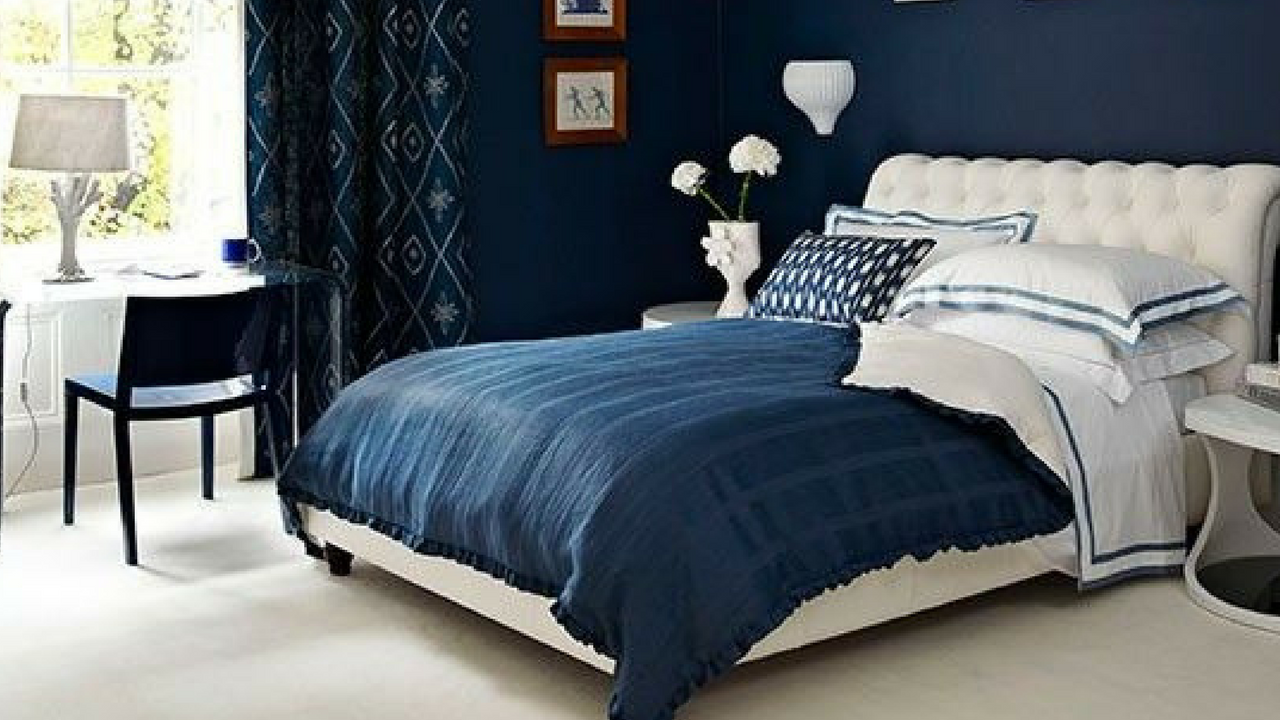 dark colours navy coloured wallpaper in a sophisticated bedroom