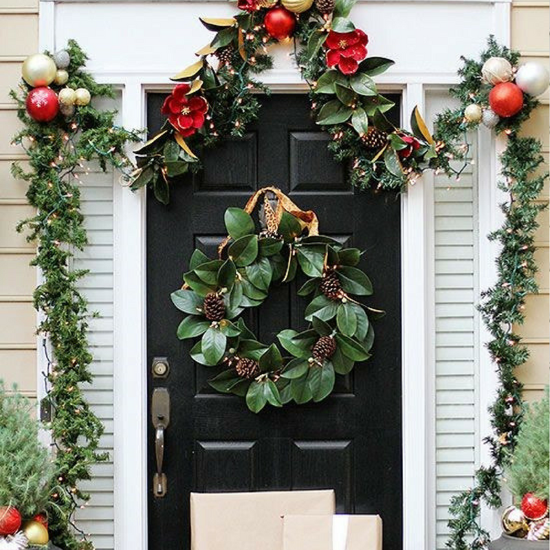 Christmas Door Wreath Decoration on a black door with a garland