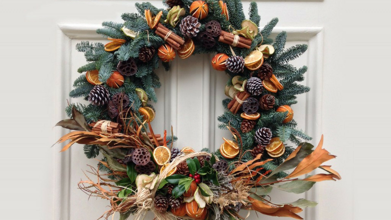 christmas themed wreath hanging on a white door