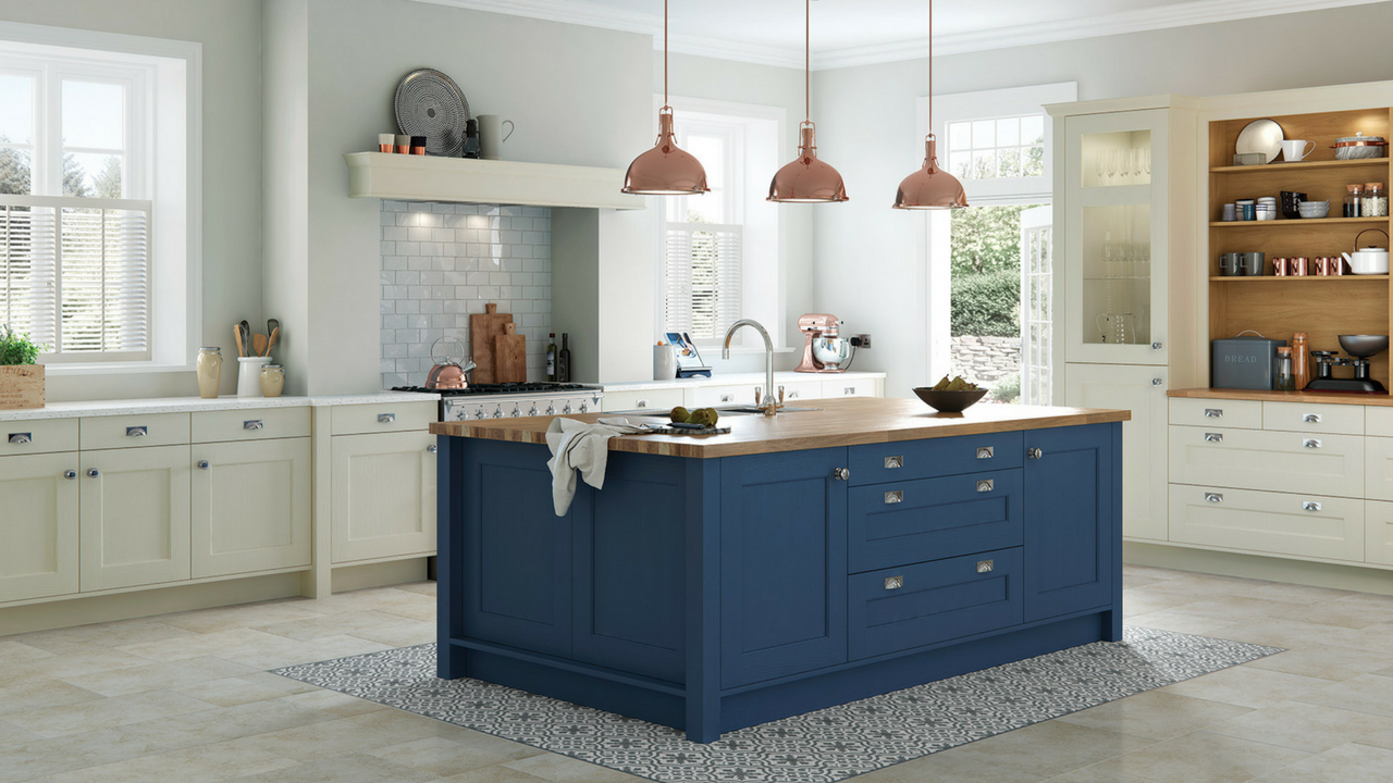dark colours subtle blue cabinets in a large open space kitchen