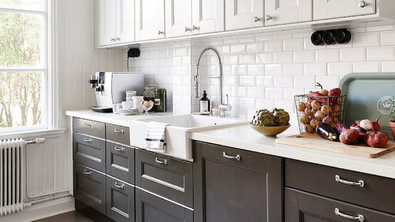 dark colours black cabinets in a white coloured kitchen