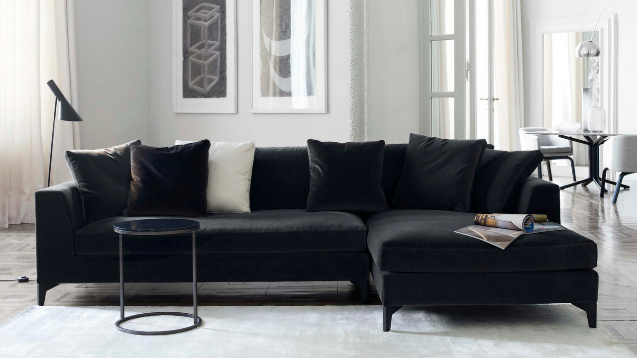 dark colours black sofa in a light coloured living room