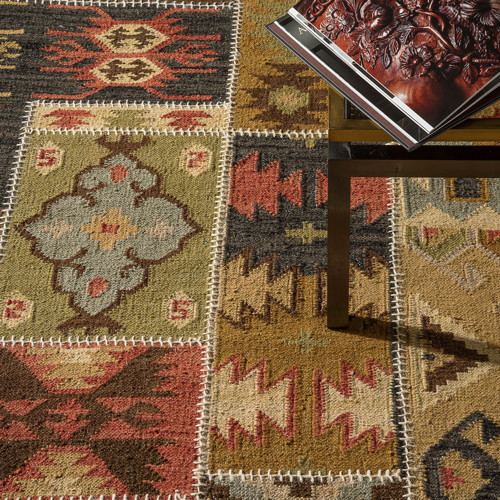 patterned kilim rug from the rug seller with table on it