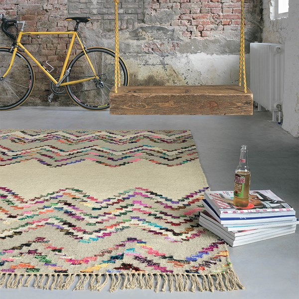 industrial room with exposed brick wall and multicoloured rug