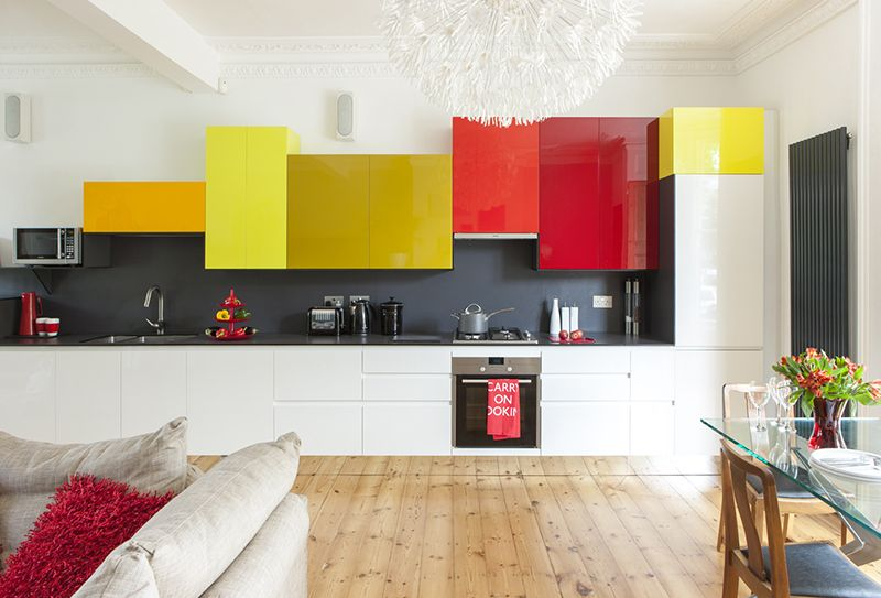 normal kitchen featuring bright red and yellow cupboards