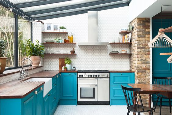 white kitchen interior with blue used as an accent colour on cupboards