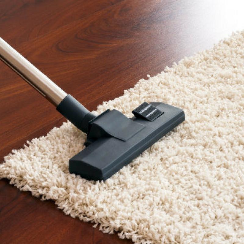 vacuuming a rug