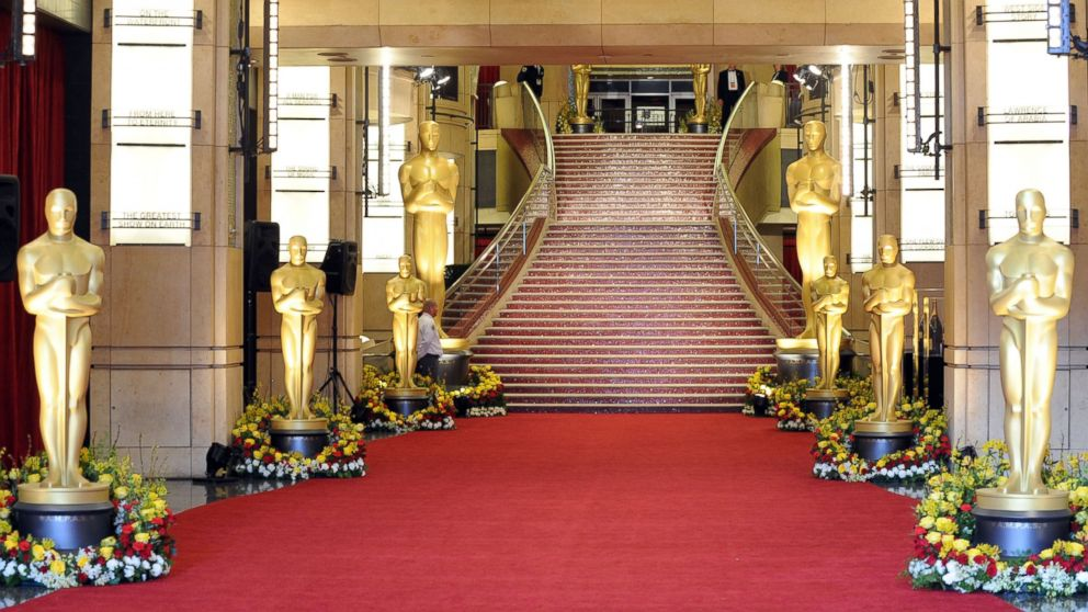 the red carpet at the oscars with the tall oscars statues spread out around the staircase