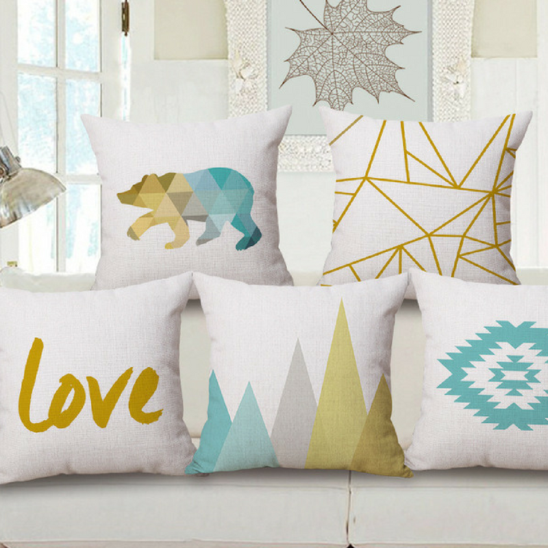 Geometric Patterns Throw Pillows in Yellow, White and Blue