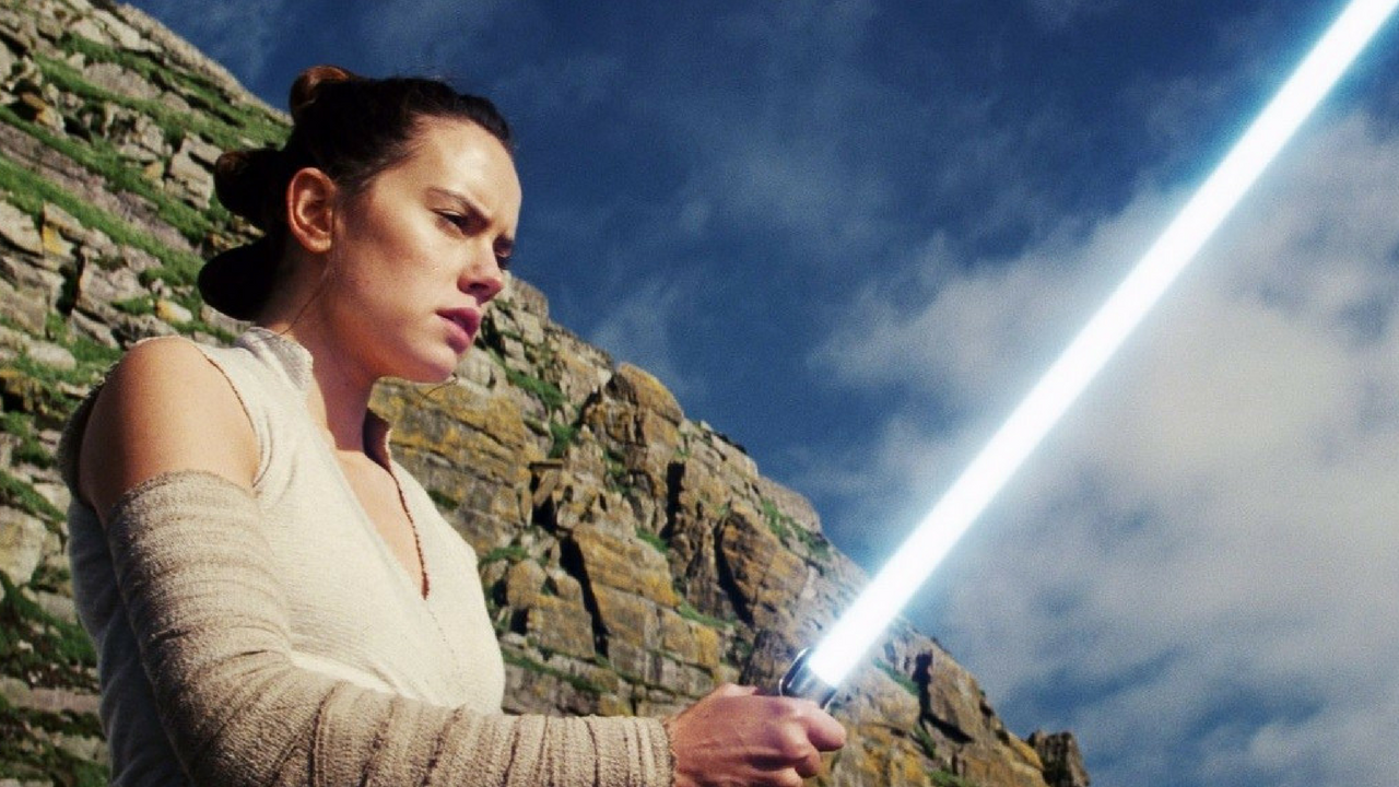 Star Wars May the 4th be with you Rey holding Luke Skywalker's Lightsaber the Last Jedi