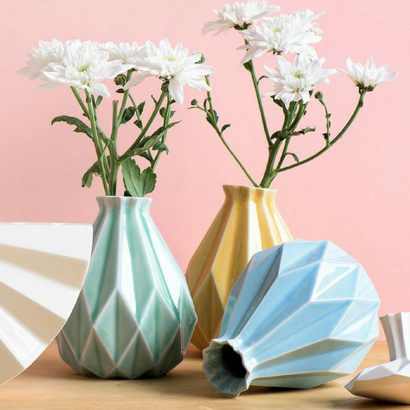 Geometric Patterns Ceramic Vases filled with white daisies