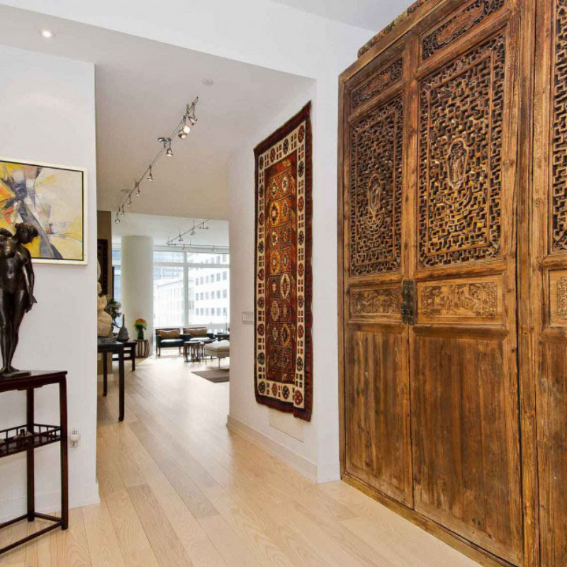 Rugs as Wall Art   Entryway with a Traditional Rug hanging on a wall