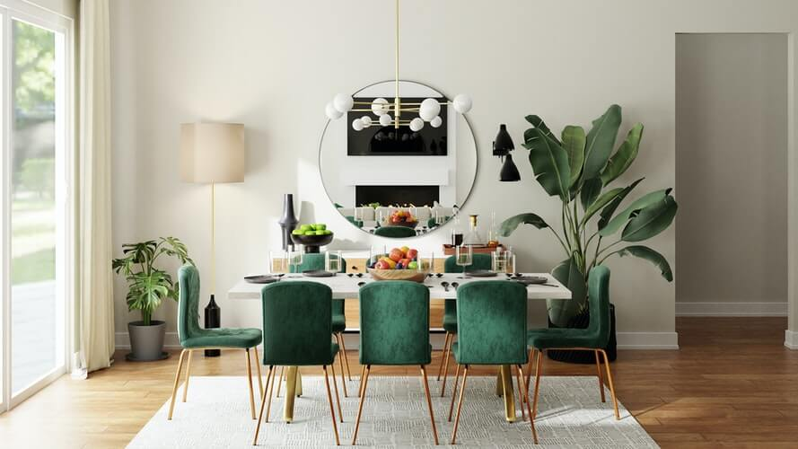 velvet chairs around a table filled with food on a dining room rug