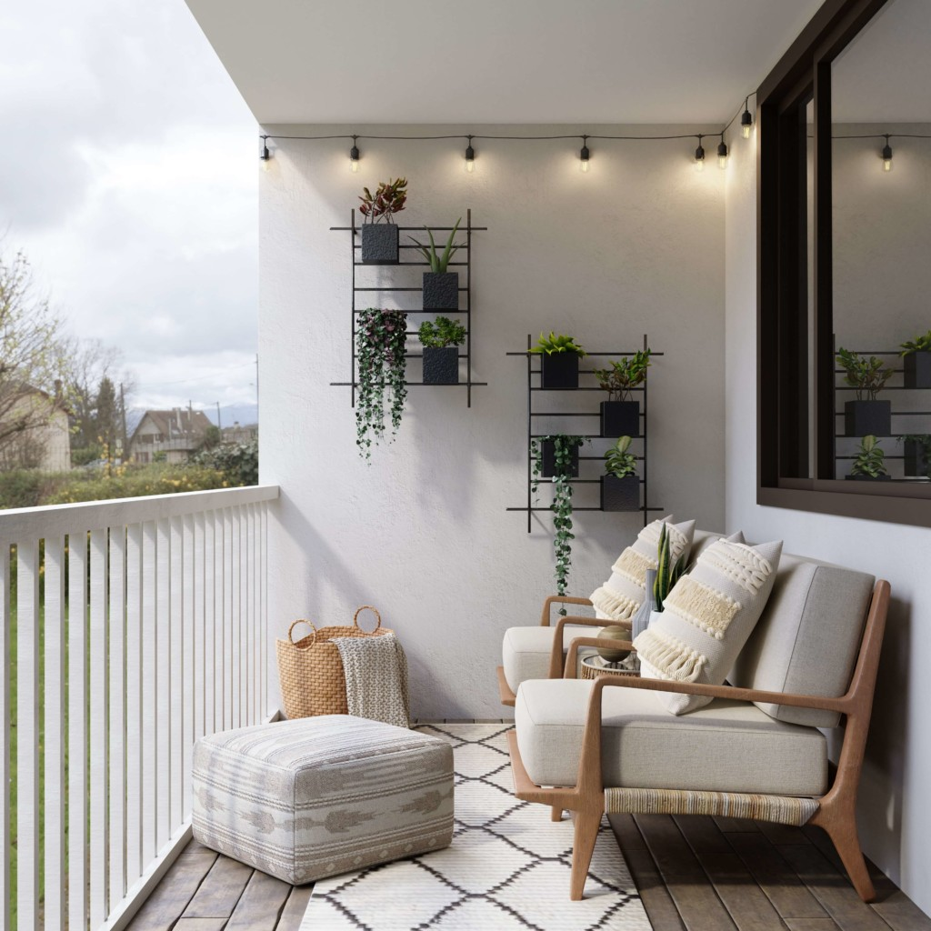 a balcony set up with a sofa next to a wall with hanging planter pots