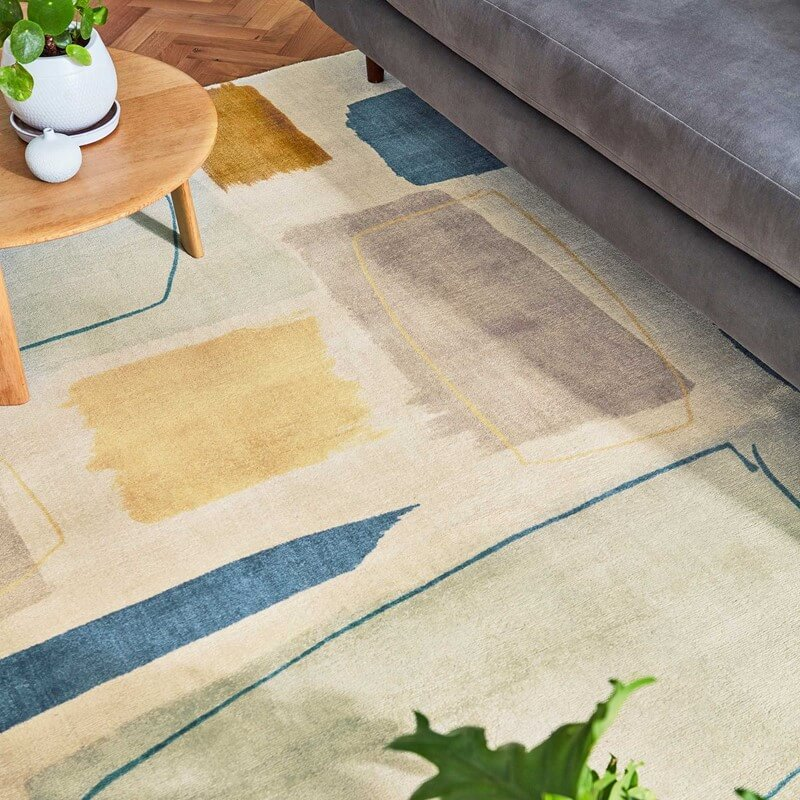 scion papaya rug in abstract design bringing colour to a living room