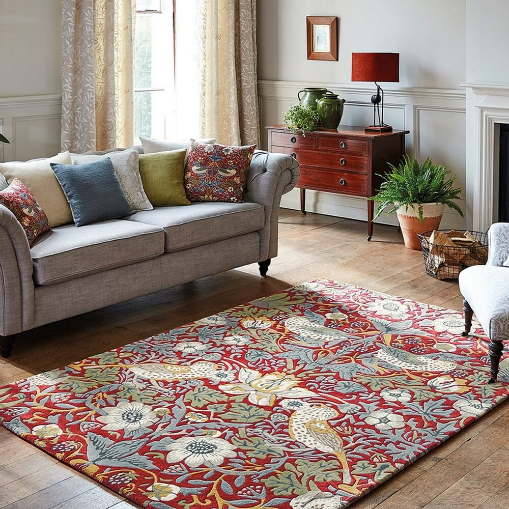 william morris strawberry thief rug in a living room space