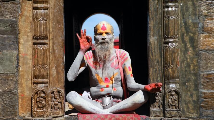 a picture of an indian guru in traditional body paint