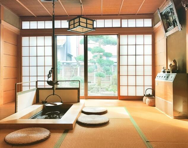 japanese style front room with wicker floors and open doors with low furniture