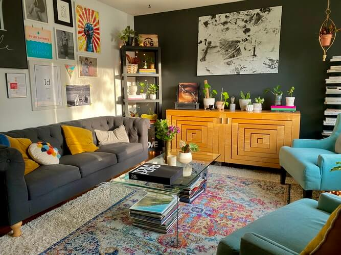 a living room with pop art prints on the wall and eclectic interiors