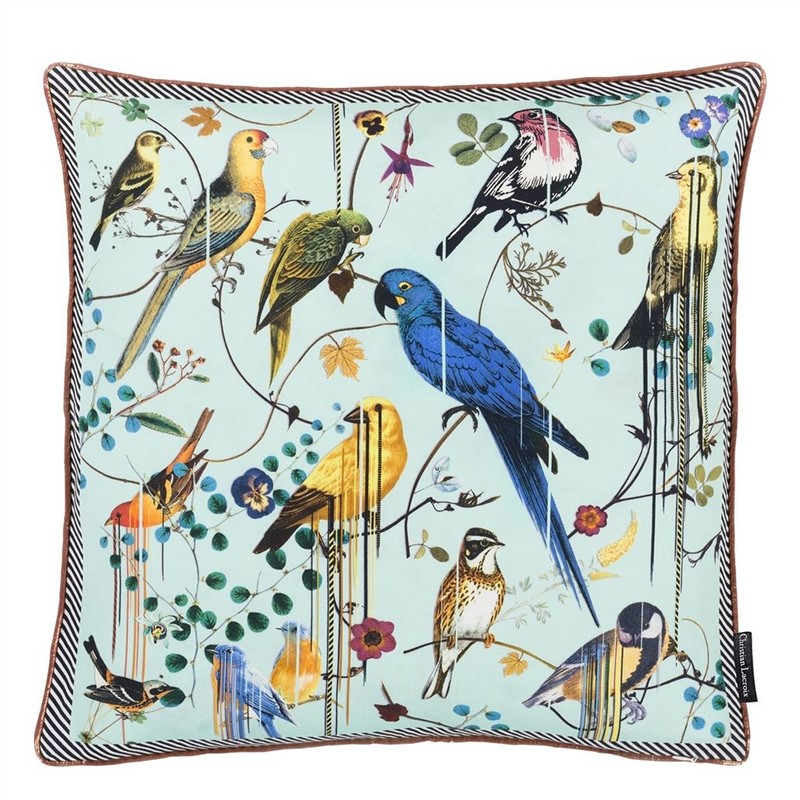 a ghost shot on white background of a Christian Lacroix bird print cushion with light blue background
