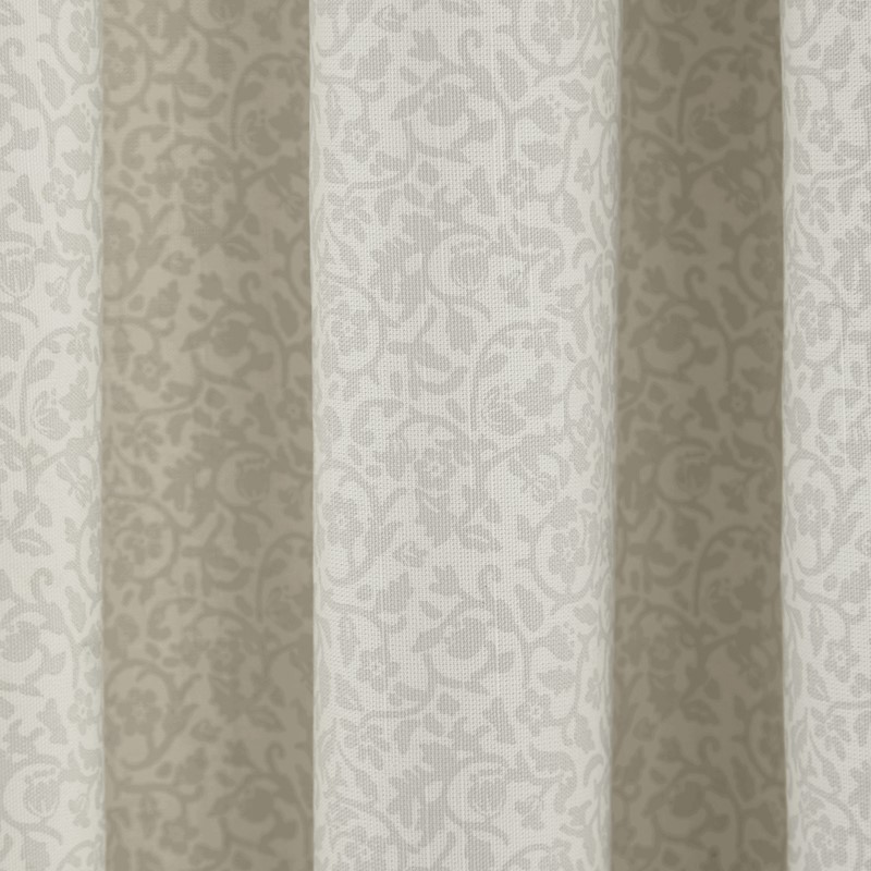 close up of morris and co wandle curtains with a neutral floral print
