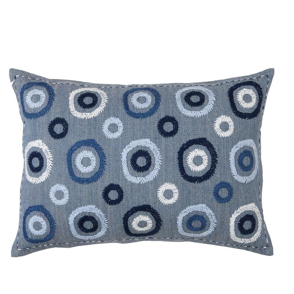 zafora cushion by william yeoward in blue with blue embroidered circles against a white cut out background.