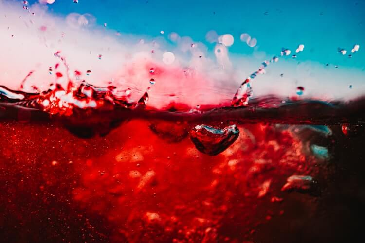 red wine close up splashing around in a glass