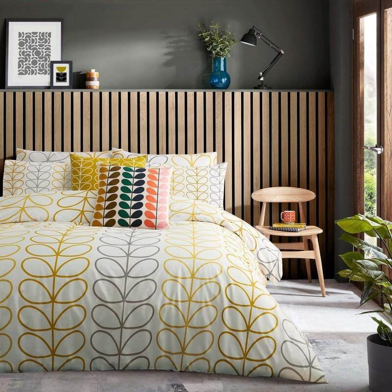 orla kiely trio stem yellow and grey bedding set in a bedroom