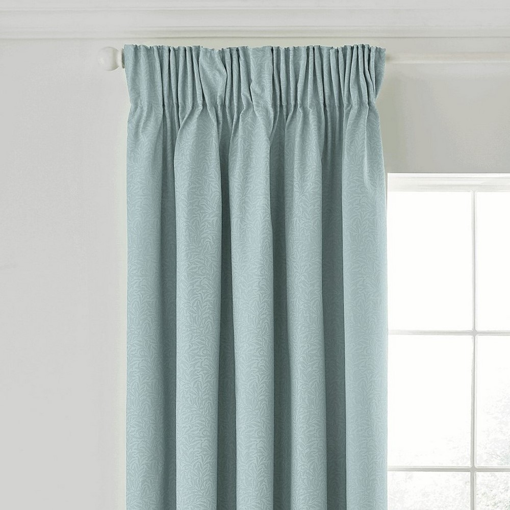 Morris & Co curtains in a window in a duck egg blue