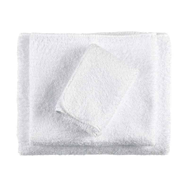 white towel set home accessories on a white background