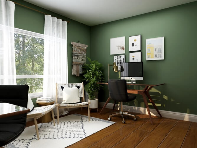 a large home office room with green walls and big windows with dark wooden floor