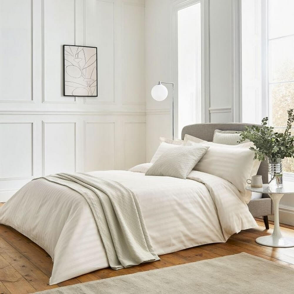 adan high thread count luxury bedding set on a bed in a light and airy bedroom