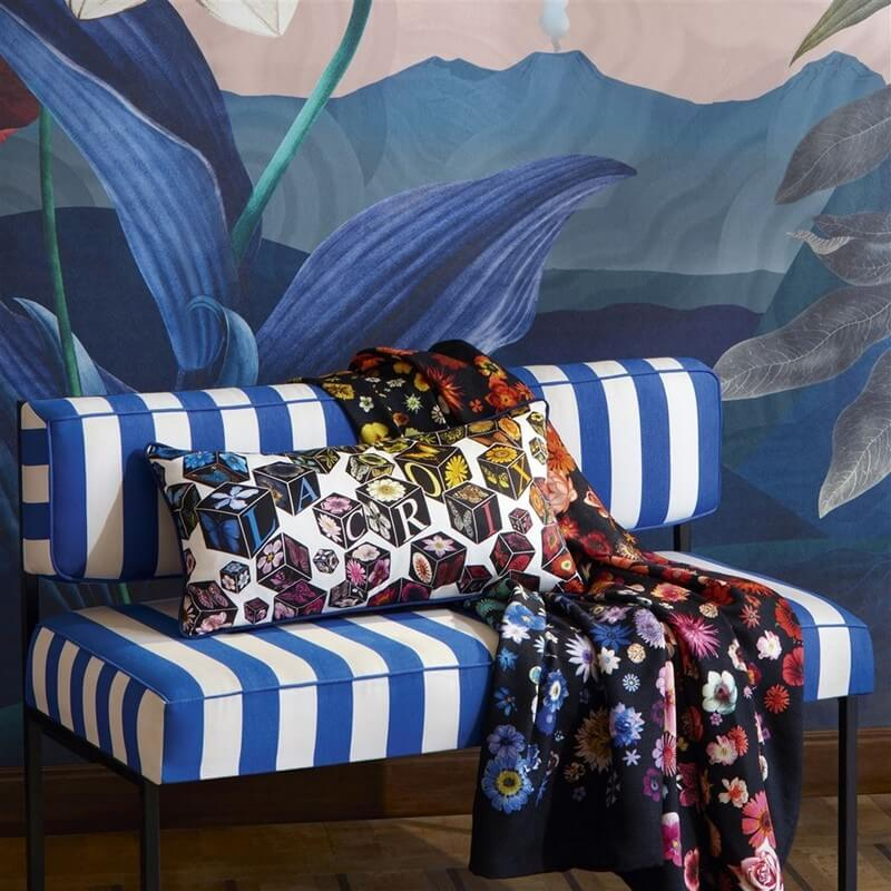 printed christian lacroix throw on a striped chair