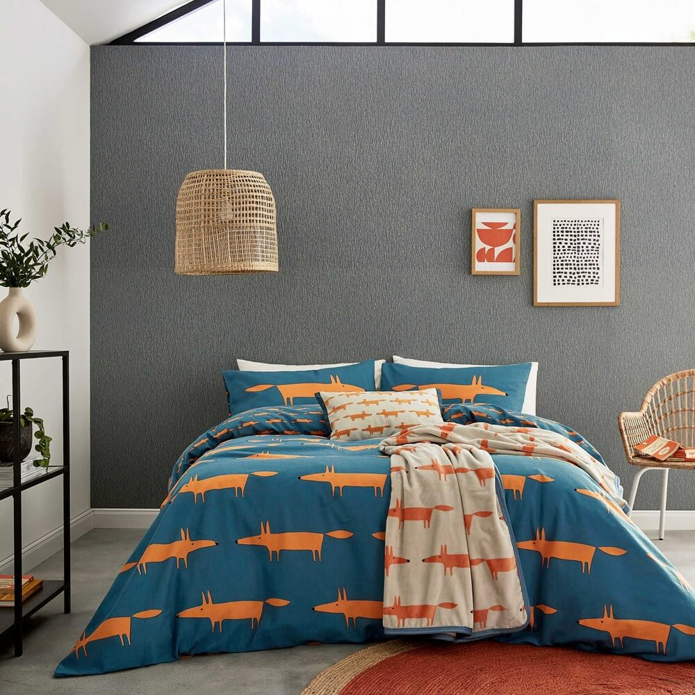 a fox print bed set by scion set on a dark blue background in a modern bedroom