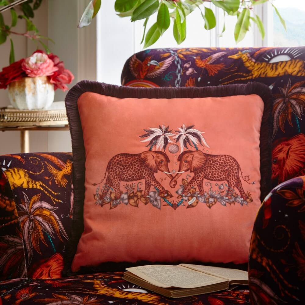 zambezi mathcin cushion on a similar printed armchair with two elephants decorating it