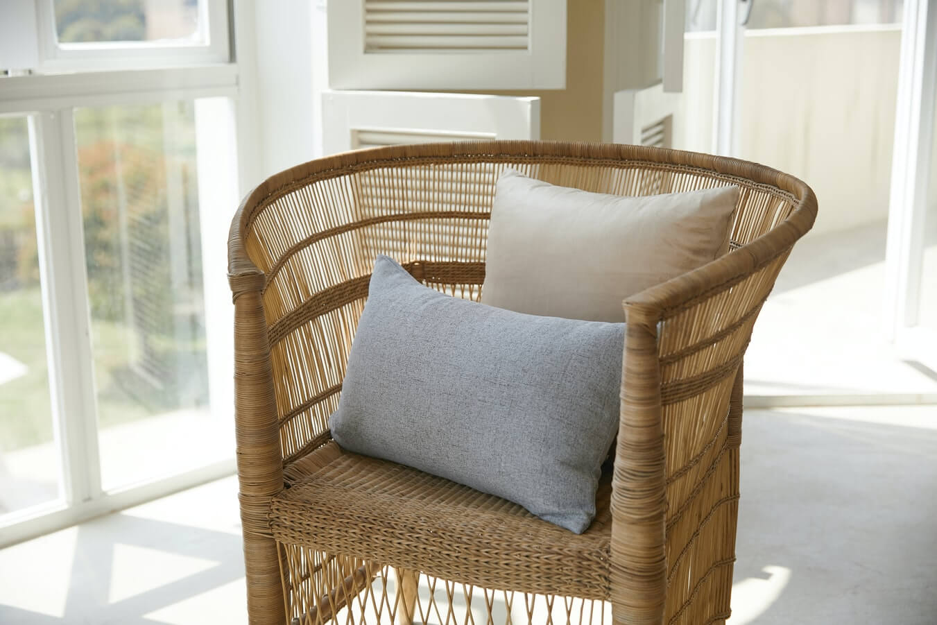 a rattan chair in a bright room